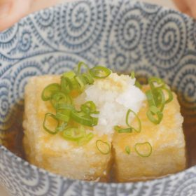 A bowl of Agedashi Tofu - Japanese vegetarian tofu dish
